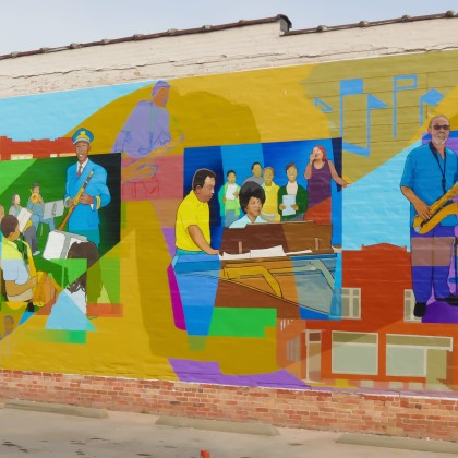 This mural celebrates the contributions African American music educators made towards the development of Kinston, NC as a music center for a variety of musical styles.